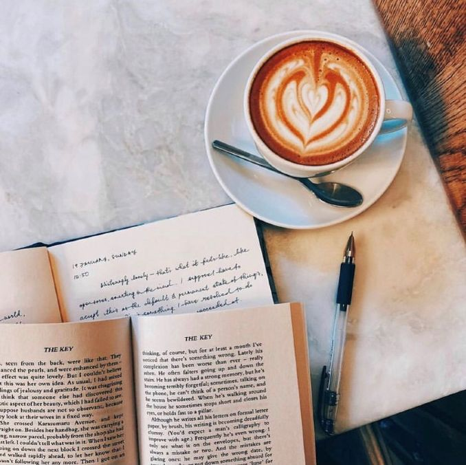 A latte and an open book