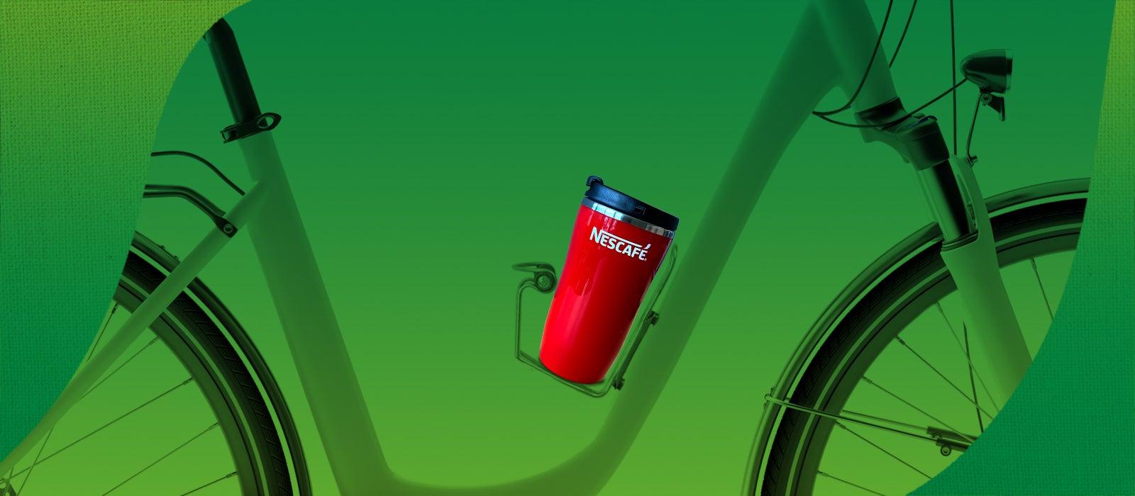 Reusable coffee cup on a bike
