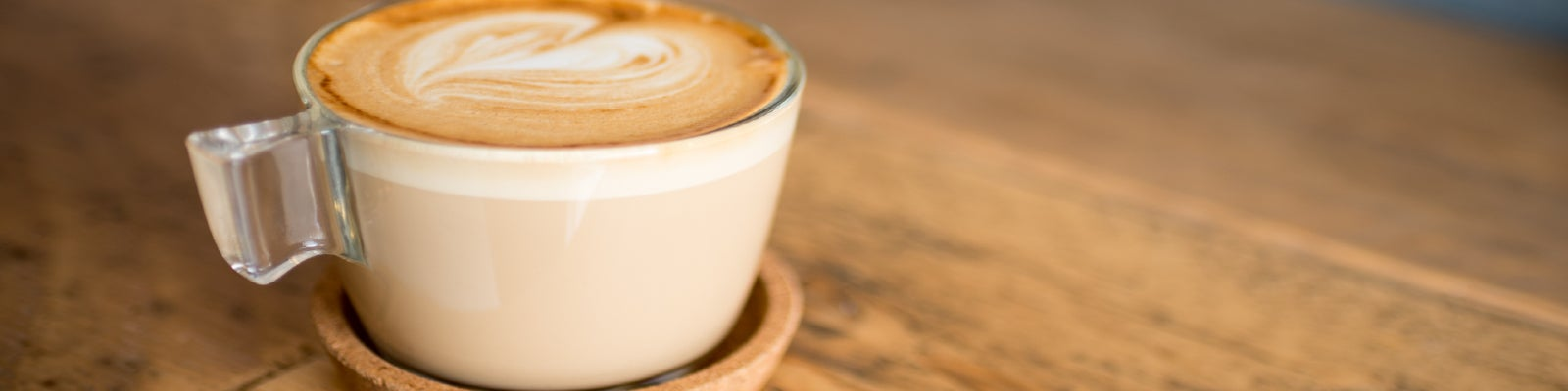 A flat white coffee in a cup