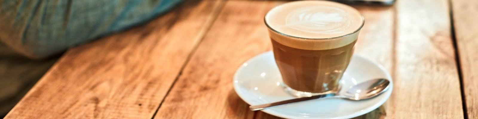 A macchiato coffee in a glass