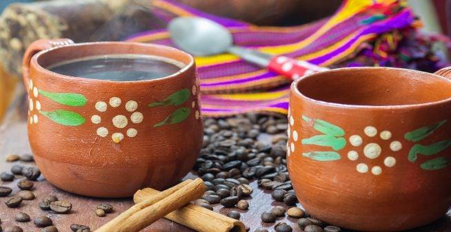 Mexican café de olla coffee in clay cup