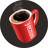 A red Nescafé mug filled with coffee on a brown circle.