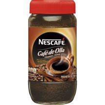 A jar of Nescafé Café de Olla with a red cap and brown label with coffee beans and a brown mug.